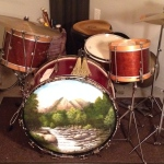 "The ""Tom Toms"" are both old Parade Drums from the early 1960's.  The Floor Tom is a 13"" Ludwig Legionairre."